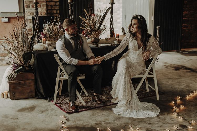 Boho Bride and Groom Holding Hands at Rustic TableScape in The Engine Works Glasgow