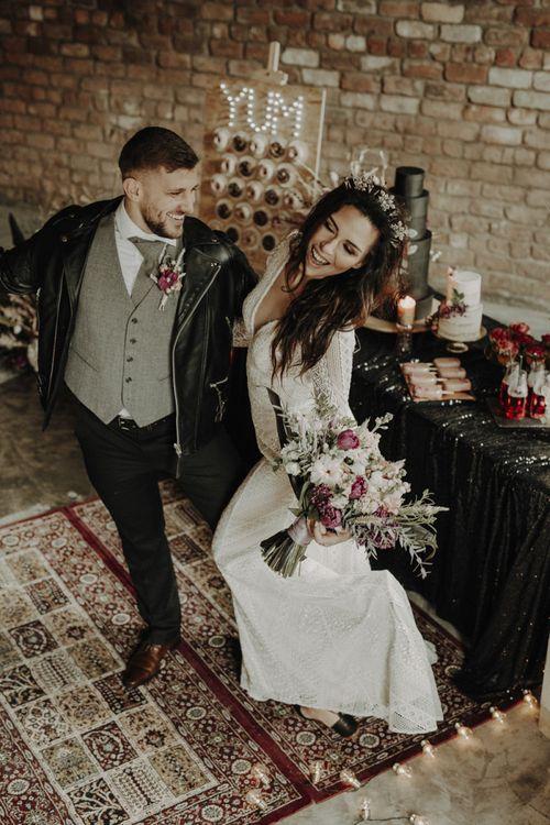 Boho Bride and Groom Dancing on Persian Rugs