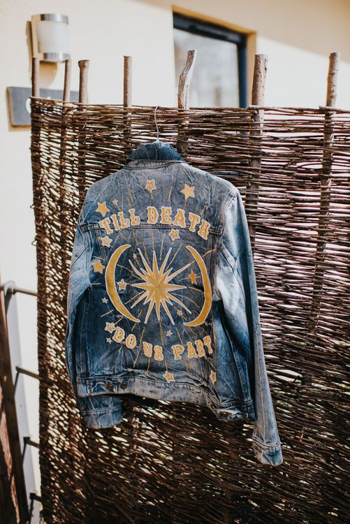 Personalised denim jacket for bride with light box sign and peg board decor