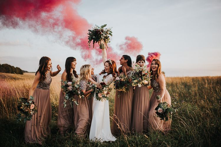 Bridesmaids in sequin dresses with wildflower bouquets