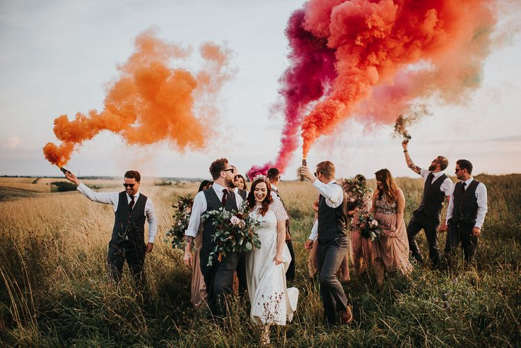 Wedding party with smoke flares