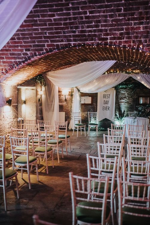 Cave Wedding Ceremony with Drapes, Fairy Lights and Best Day Ever Sign