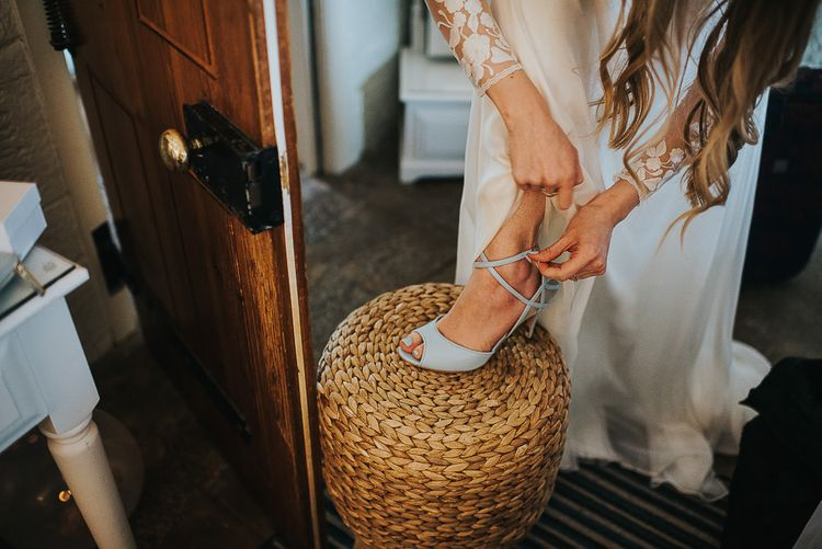 Bride Putting On Charlotte Mills April Blue Shoes