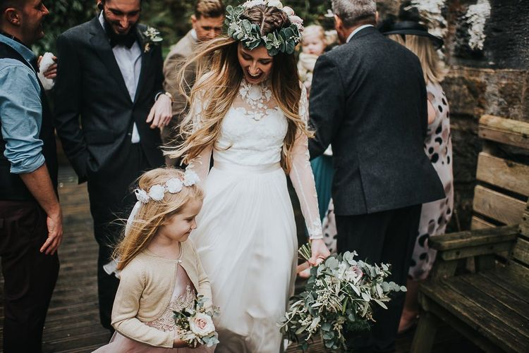 Bride in Catherine Deane Wedding Dress and Flower Girl in Monsoon Dress