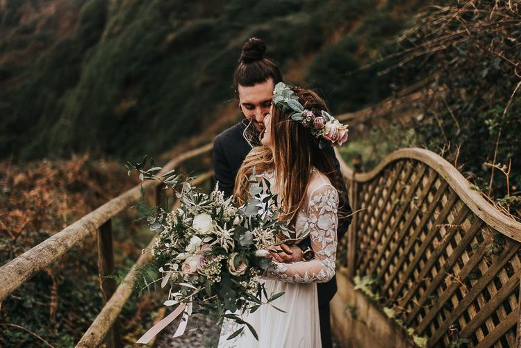 Groom Hugging his Bride in Catherine Deane Separates with Lace Long Sleeves