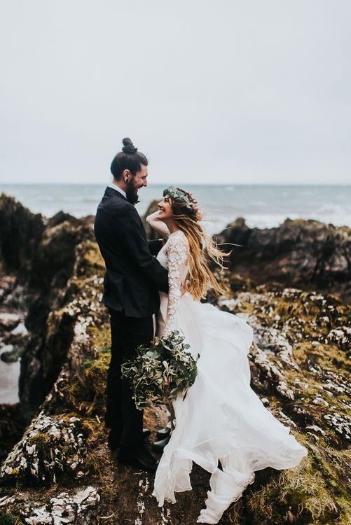 Coastal Portrait of Bride in Catherine Deane Separates and Flower Crown and Groom in Tuxedo