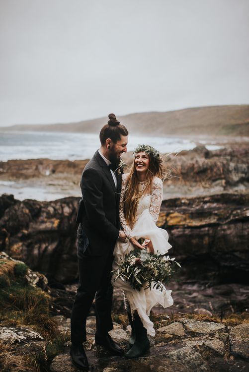 Coastal Portrait with Groom in Black Tie Suit and Top Knot and Bride in Catherine Deane Jessica Bodysuit and Anika Skirt Separates