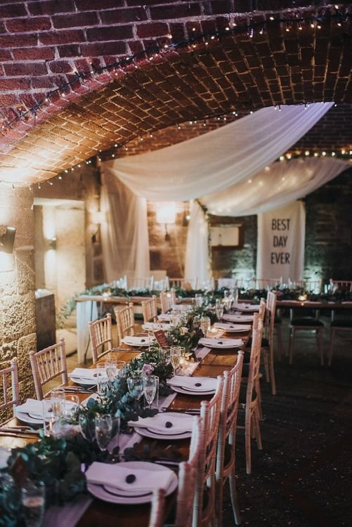 Cave Wedding Reception with Fairy Lights, Drapes and Greenery Decor