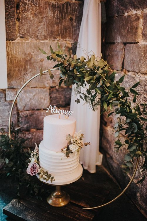 Two Tier White Wedding Cake on Gold Cake Stand with Floral Hoop Decor
