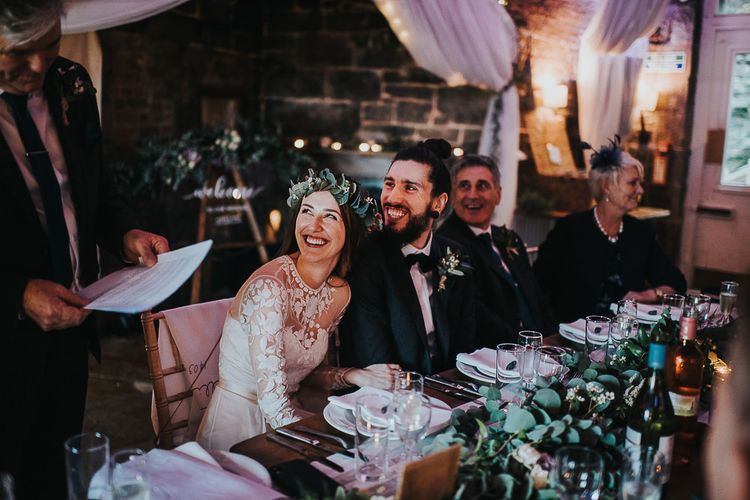 Bride and Groom Smiling During Wedding Reception Speeches