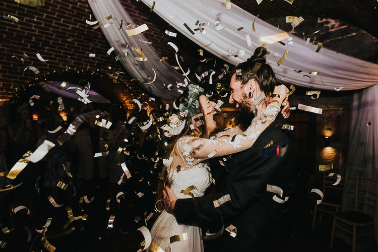 Dance Floor Gold Confetti Bomb Moment with Bride in Catherine Deane Separates and Flower Crown and Groom in Tuxedo