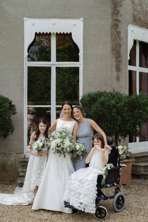 Bride With Wedding Party Flower Girls In White Dresses // Satin Mikaella Bridal Wedding Dress With Long Train For Elegant White & Green Wedding At Pennard House Somerset With Images By Captured By Katrina