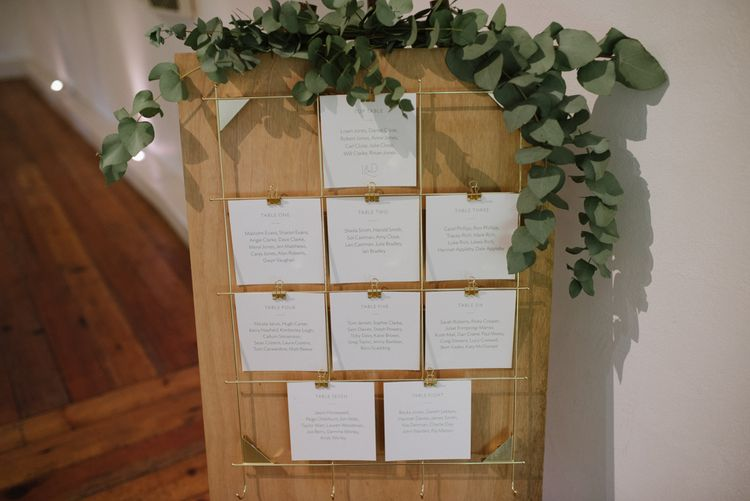 Rustic Table Plan With Gold Detail //Outdoor Wedding Ceremony At Pennard House // Satin Mikaella Bridal Wedding Dress With Long Train For Elegant White & Green Wedding At Pennard House Somerset With Images By Captured By Katrina