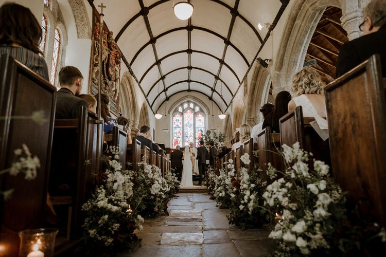 Floral Lined Aisle For Church Wedding Ceremony // Boconnoc Cornwall Weekend Wedding With Bride In Halfpenny London & Groom In Paul Smith With Images From The Curries