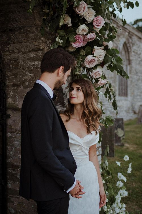 Floral Arch For Church // Boconnoc Cornwall Weekend Wedding With Bride In Halfpenny London & Groom In Paul Smith With Images From The Curries