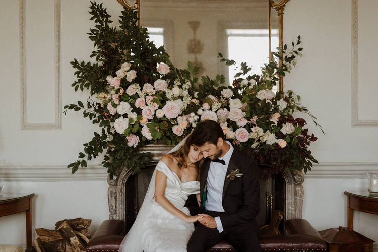 Floral Installation Over Fireplace For Wedding // Boconnoc Cornwall Weekend Wedding With Bride In Halfpenny London & Groom In Paul Smith With Images From The Curries