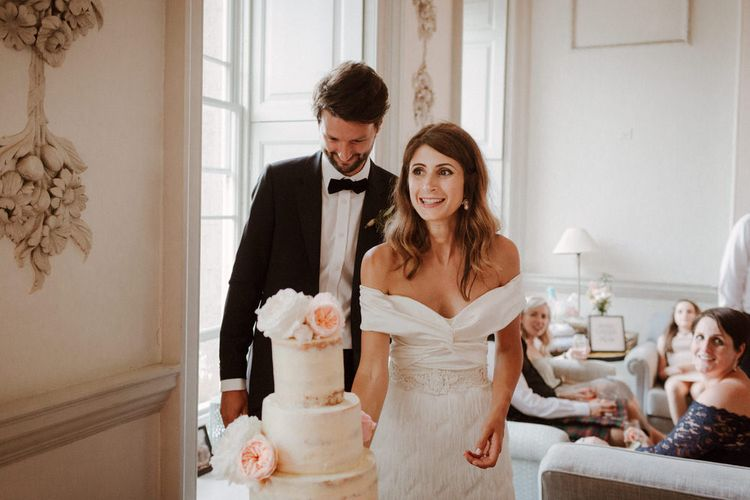 Cutting The Cake // Boconnoc Cornwall Weekend Wedding With Bride In Halfpenny London & Groom In Paul Smith With Images From The Curries