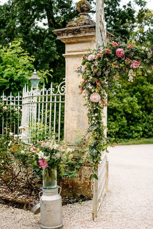 Wedding Gated Decorated with Green and Pink Flowers