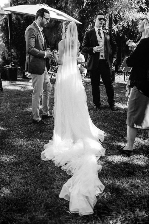 Bride in Pronovias Wedding Dress with Long Train and Veil