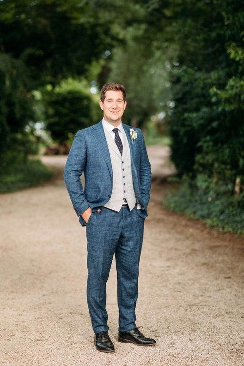 Groom in Blue and Beige Suit Supply Suit