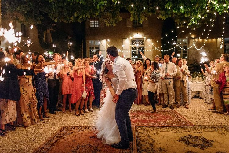 Bride and Groom's First Dance Under a Festoon Lit Courtyard