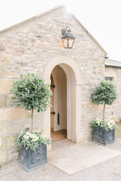 Topiary trees at wedding venue entrance