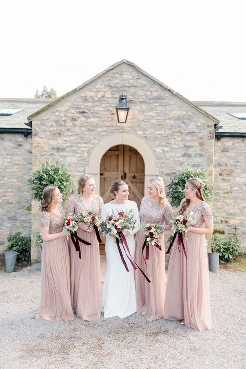 Bridal party portrait with bridesmaids in blush dresses
