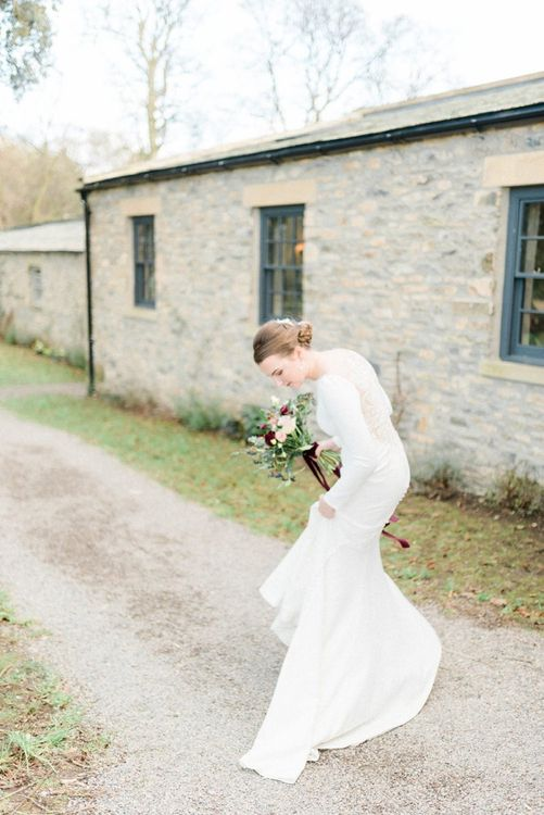 Bride in lace back Justin Alexander wedding dress