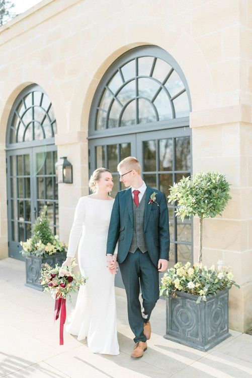 Bride and groom portrait outside Middleton Lodge Fig House wedding venue