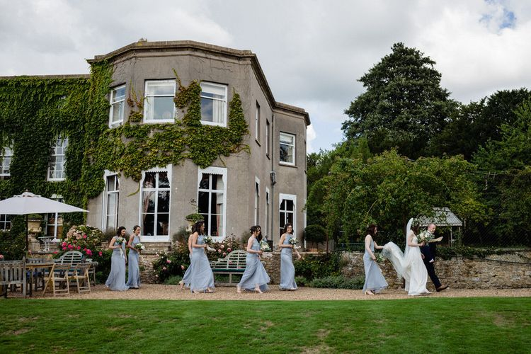 Bridal Party Walking Past Pennard House Wedding Venue