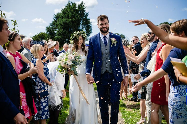Confetti Moment with Bride in Charlie Brear Wedding Dress and Groom in Navy Ted Baker Suit