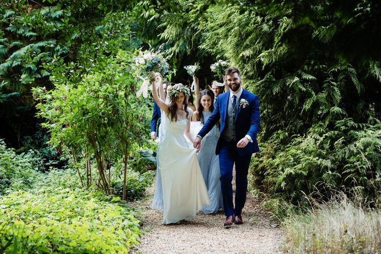 Bride in Charlie Brear Wedding Dress and Groom in Navy Ted Baker Suit