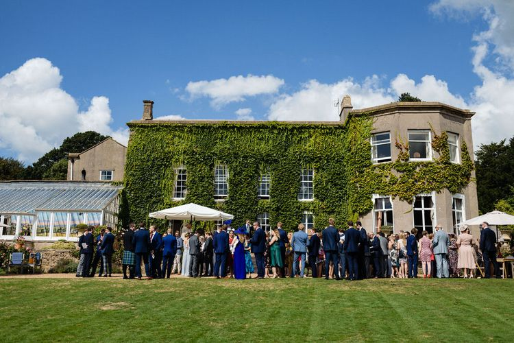 Wedding Guests Enjoying Drinks Reception at Pennard House Wedding Venue