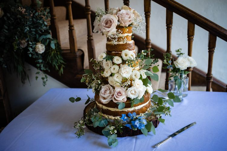 Naked Wedding Cake with Wild Flower Wedding Decor