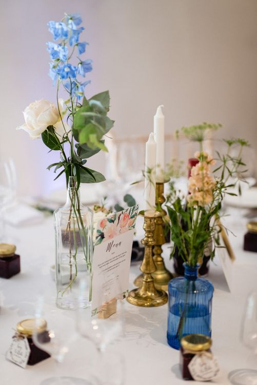 Flower Stems in Vases and Candles Sticks as Wedding Reception Table Centrepiece Decor