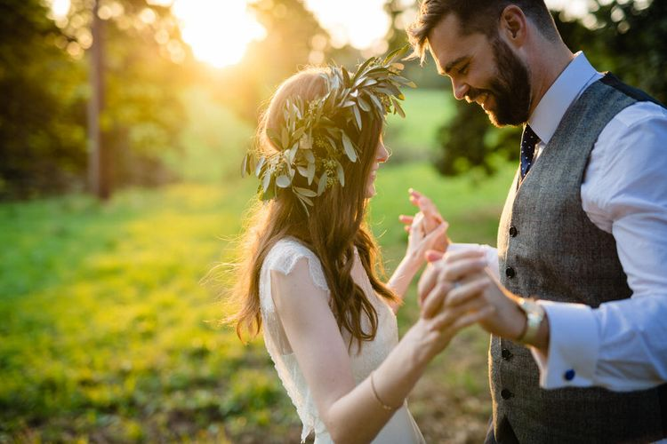 Golden Hour Portrait of Bride in Charlie Brear Wedding Dress and Olive Flower Crown with Groom in Ted Baker Navy Suit