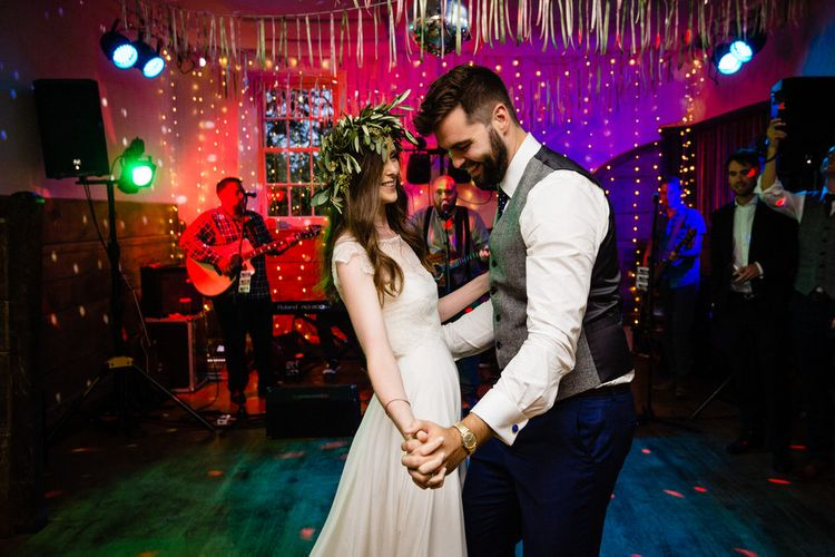First Dance with Bride in Charlie Brear Wedding Dress and Olive Flower Crown with Groom in Ted Baker Navy Suit