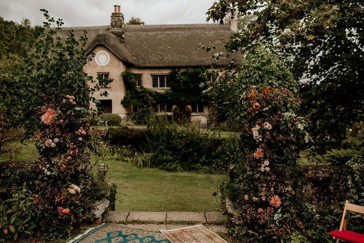 Devon wedding venue for with flower pillars for September wedding