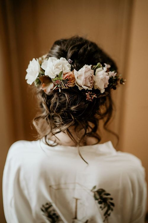 Floral hairpiece with pinned undo for bride