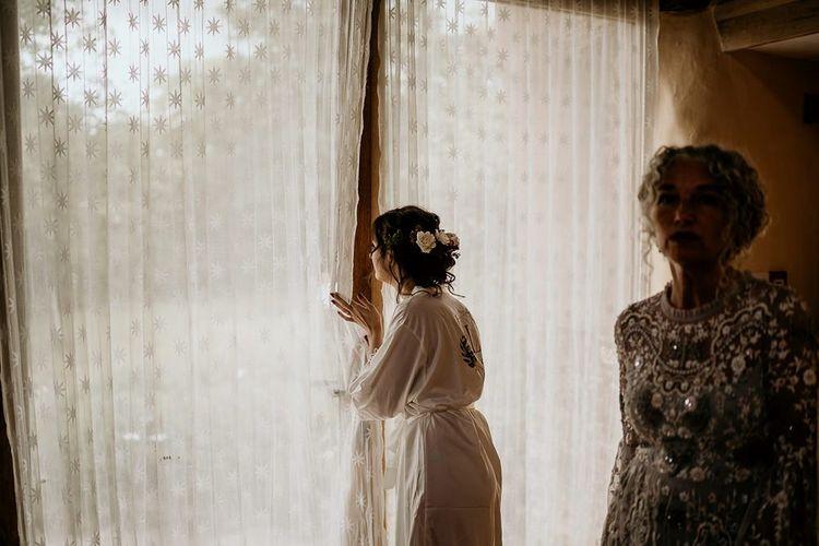 Bride takes a peak at September wedding ceremony set-up