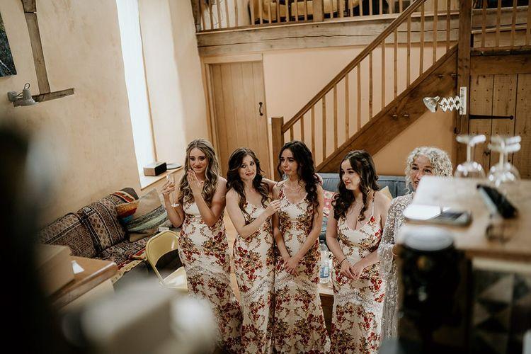 Bridesmaids wear floral dresses for September wedding