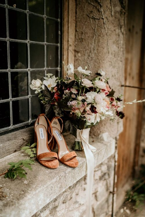 Wedding flowers with wedding shoes for September wedding