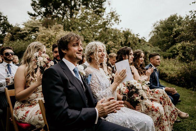 Guests enjoy outdoor September wedding ceremony