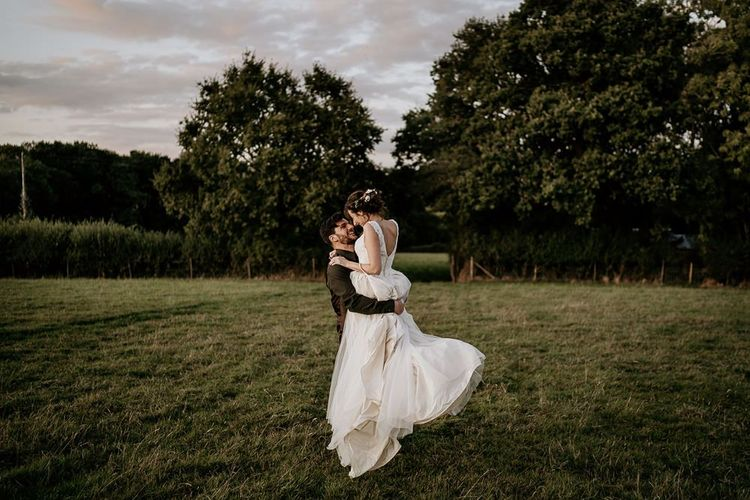 Bride and groom steal a moment during September wedding