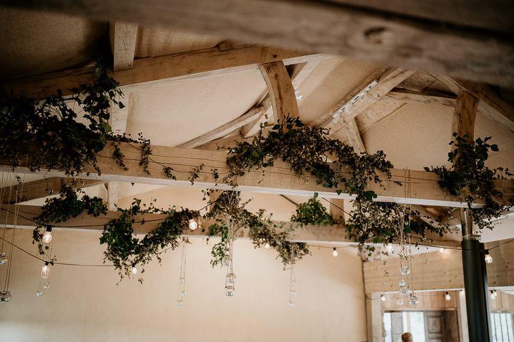 Exposed beams at barn wedding