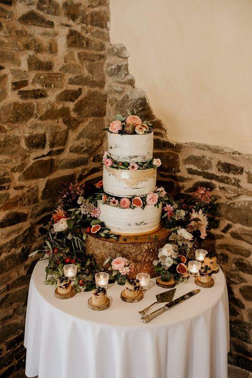 Gold foil wedding cake with flower decor