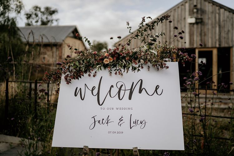 Wedding welcome sign with flower decor