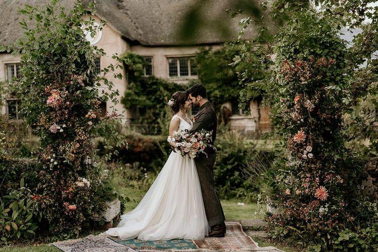 Floral pillars for outdoor September wedding ceremony