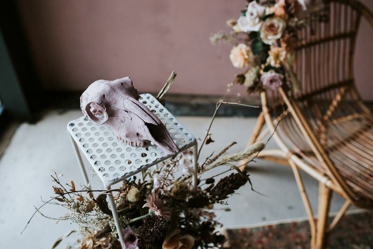 Skull Wedding Decor with Dried Flowers & Wicker Chair
