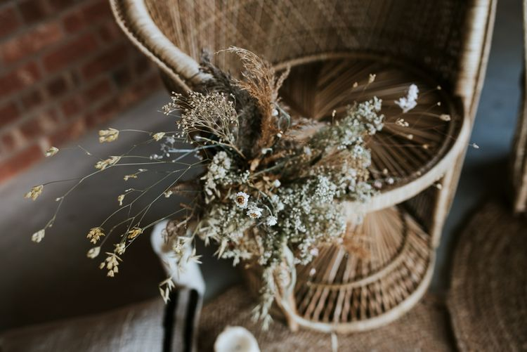 Peacock Chair with Dried Flowers Bouquet
